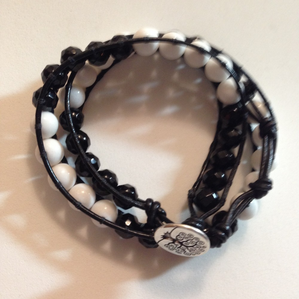 Made with white Jade beads and black facetted onyx beads