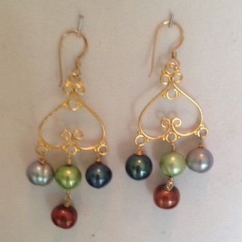 Earrings made with beautfiul fresh water pearls, gold and crystals