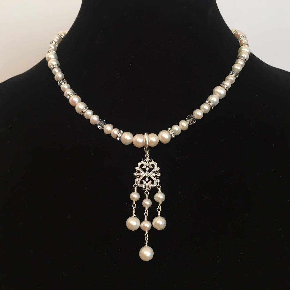 Nacklace made with Pearls, Crystals, and Silver