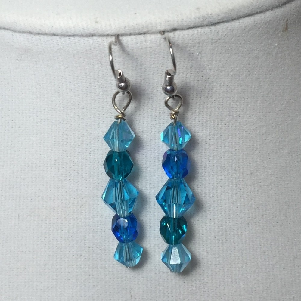 Long earrings made with crystals