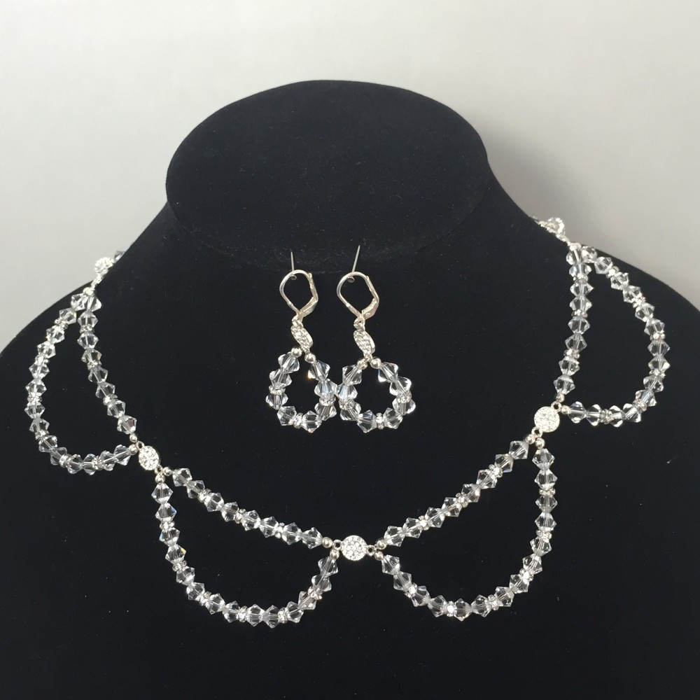 Set of earrings and necklace made with crystals and silver