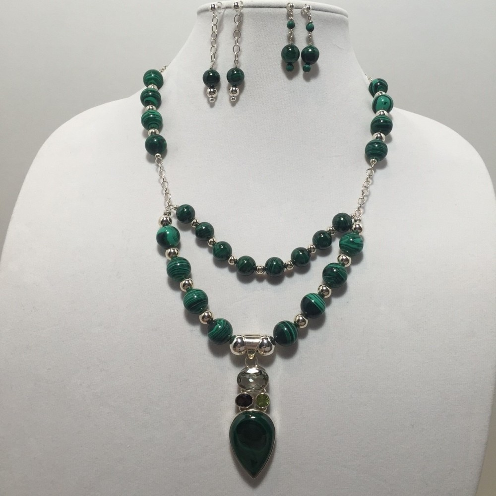 Set of earrings are necklace made with Malachite, Amethyst, Peridot, Smokey Quartz, and Sterling Silver