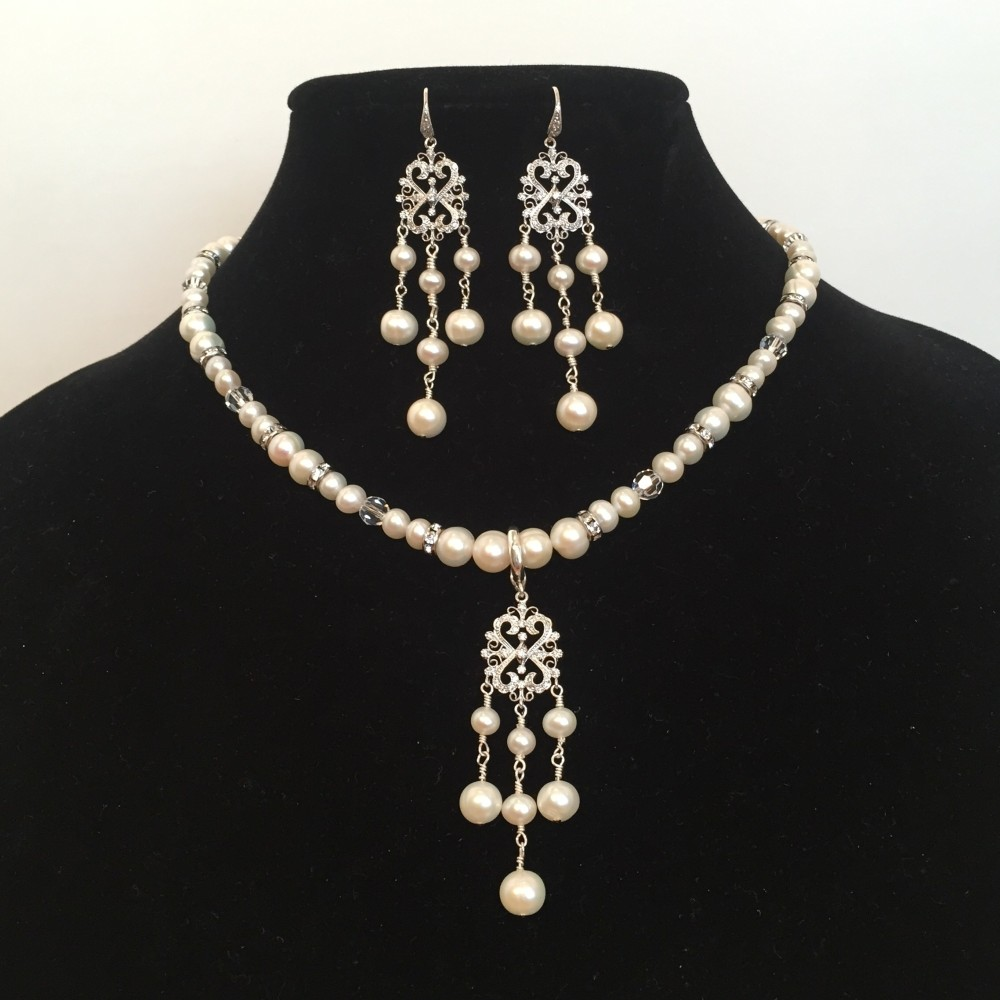 Set of earrings and necklace made with Pearls, Crystals, and Silver